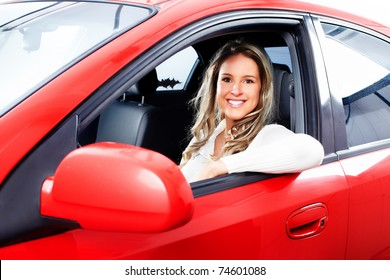 Smiling young pretty woman  in the car