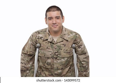 Smiling young soldier with crutches