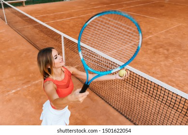 smiling young sporty girl playing tennis