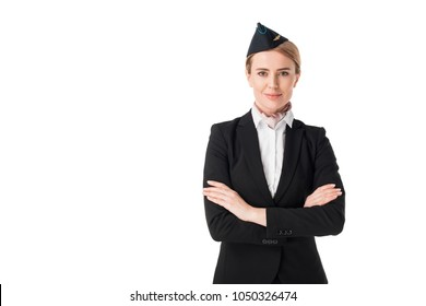 Smiling young stewardess looking at camera isolated on white