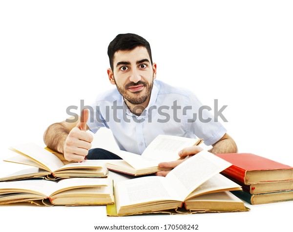 Smiling young student preparing for exam. Isolated on white background