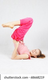 Smiling young  teenage girl doing fitness exercises