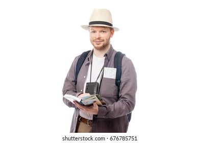 smiling young tourist isolated over white background
