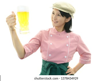 A smiling young waitress.