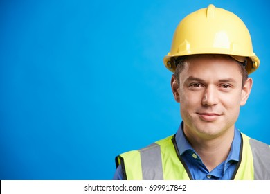 Smiling young white construction worker in hard hat