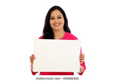Smiling young woman with blank white board