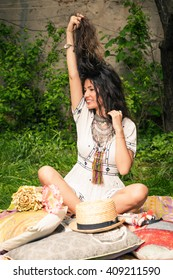 smiling young woman in boho style dress and jewelry enjoy in garden summer day full body shot