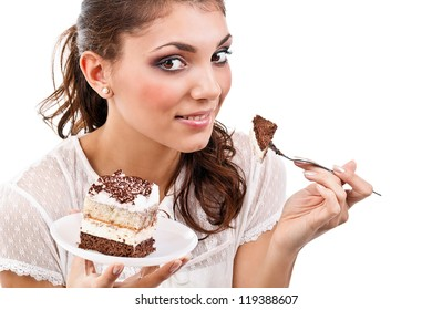 Smiling young woman with a cake slice on a plate