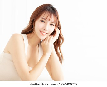 smiling young woman with clean perfect skin
