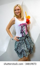smiling young woman with cocktail flirting in a bar