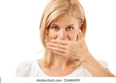Smiling young woman covering mouth over background