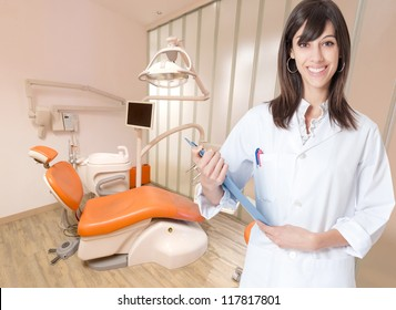 Smiling young woman in a dental clinic