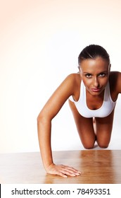 smiling Young Woman Doing Pushups isolated on white
