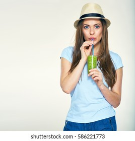 Smiling young woman drinking green  smoothie juice. Isolated portrait.