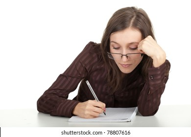 smiling young woman in eyeglasses writing on blank card