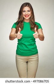 smiling young woman in green t shirt show thumbs up. isolated portrait. long hair.
