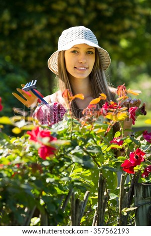 Smiling Young Woman Hat Gardening Roses Stock Photo (Edit Now ...
