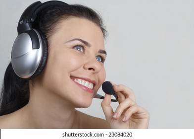 Smiling young woman with headset