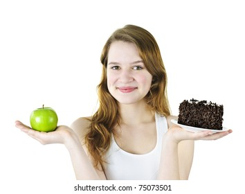 Smiling young woman holding apple and chocolate cake
