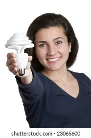 Smiling young woman holding energy saving fluorescent light bulb
