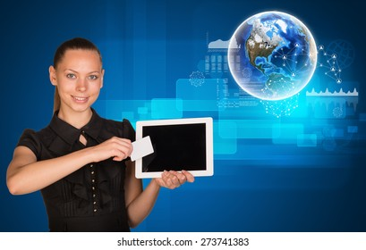 Smiling young woman holging tablet and blank card with 3d Earth model and looking at camera on abstract blue background. Elements of this image furnished by NASA