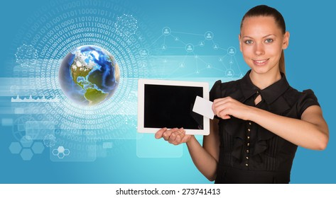 Smiling young woman holging tablet and blank card with 3d Earth model with numbers around and looking at camera on abstract blue background. Elements of this image furnished by NASA