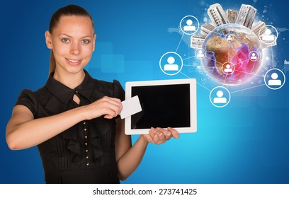 Smiling young woman holging tablet and blank card with 3d Earth model with cityscape on and looking at camera on abstract blue background. Elements of this image furnished by NASA