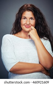 Smiling Young Woman Looking On Grey Background