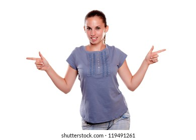 60f14accc04 Smiling young woman looking at you and pointing to her left and right on  blue shirt