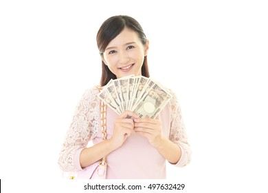 Smiling young woman with money