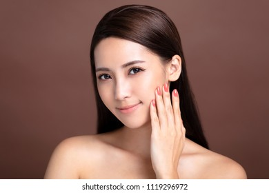 smiling young woman with natural makeup and clean skin