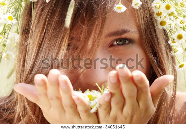 Smiling young woman on the meadow