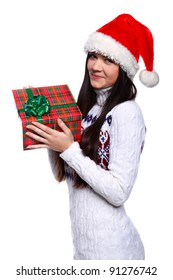 Smiling young woman in red Christmas hat at white background with gifts