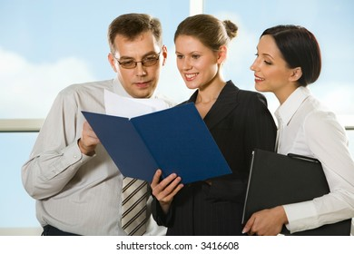 Smiling young woman showing documents to her boss and curious girl looking into the paper case