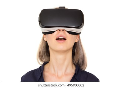 smiling young woman using vr glasses. Virtual reality headset. Isolated
