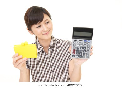 Smiling young woman with wallet
