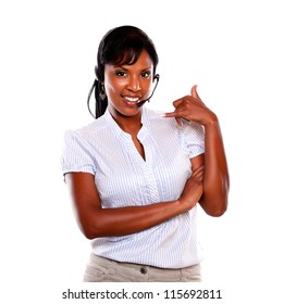 Smiling young woman wearing a headphones saying call me with the hand on isolated background