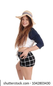 A smiling young woman wearing a straw hat and black checkered shorts 