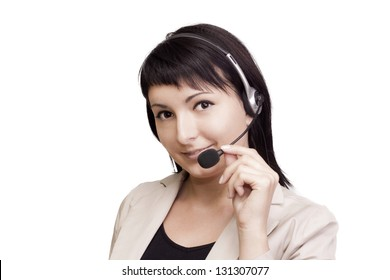 A smiling young woman wearing a telephone headset.