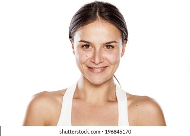 smiling young woman without make-up