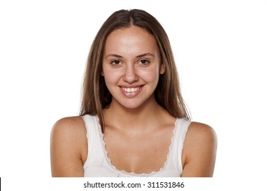 smiling young woman without make-up, looking at the camera