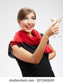Smiling young womanportrait with cocktail glass dressed black dress and red scarf. isolated portrait.