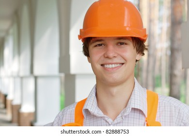 Smiling young worker outdoors with copy space