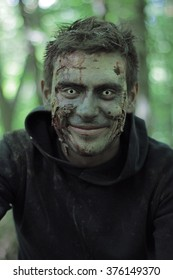 Smiling zombies in a forest.