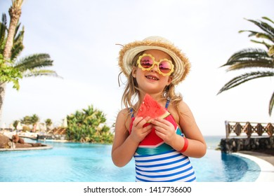 Smilling little girl eating watermelon. Summer, hollidays, travel concept.