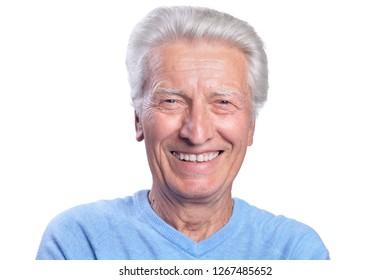 Smilling senior man posing on white background