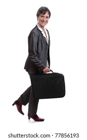 smimling mature businesswoman walking with laptop case isolated on white background