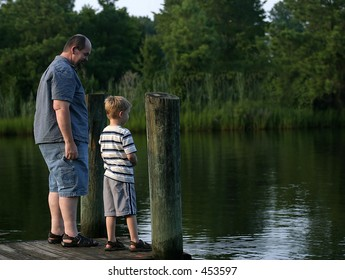 Smirk.. A father and son talking at the end of a pier