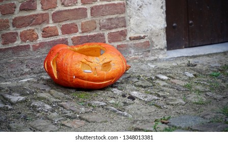 Smirking carved pumpkin on the street
