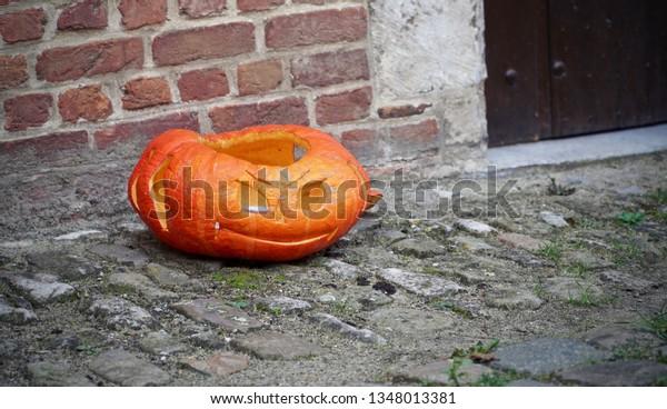Smirking carved pumpkin on the street